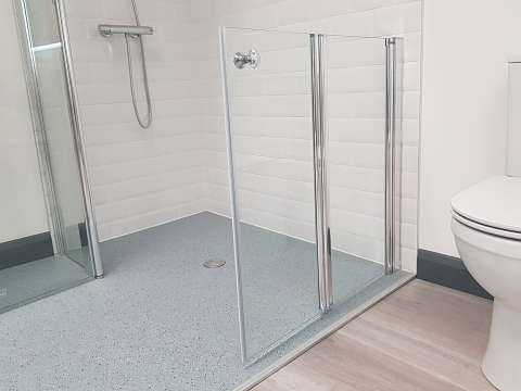 half height bifold shower door for accessible bathroom