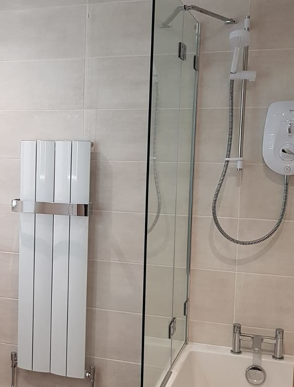 electric shower in bathroom at Eldwick near Bingley