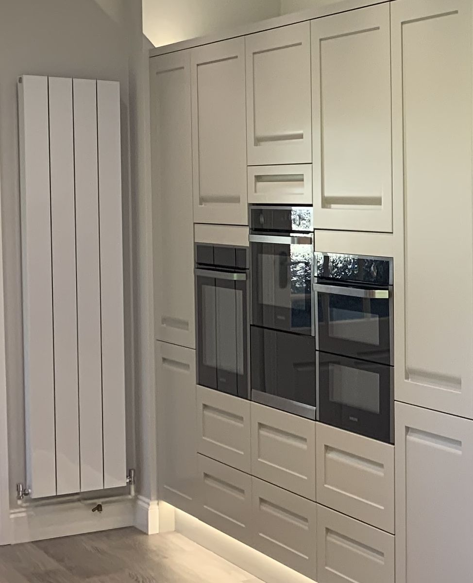 tripple ovens and feature radiator at Bingley kitchen