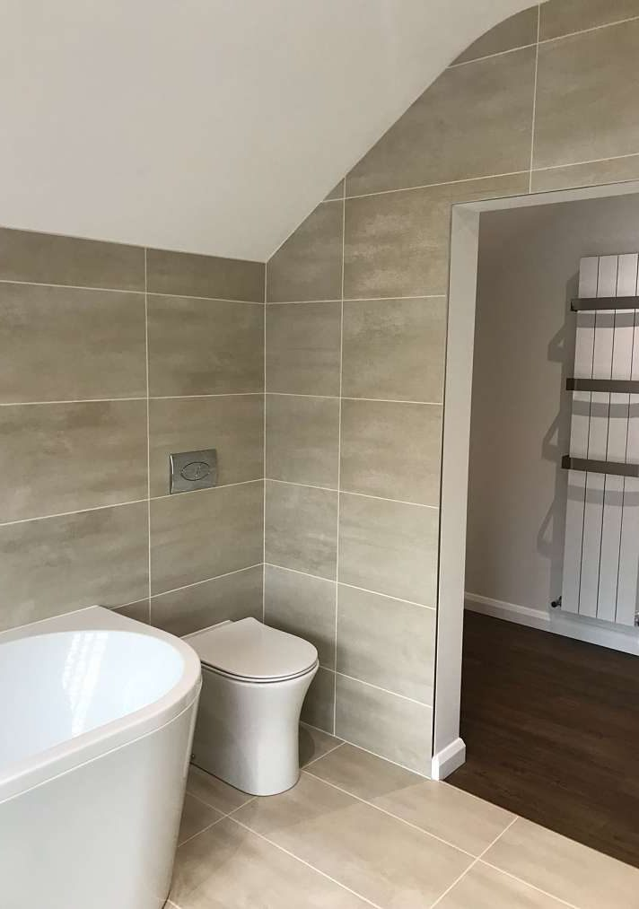 bathroom wall altered to allow easy access to dressing room