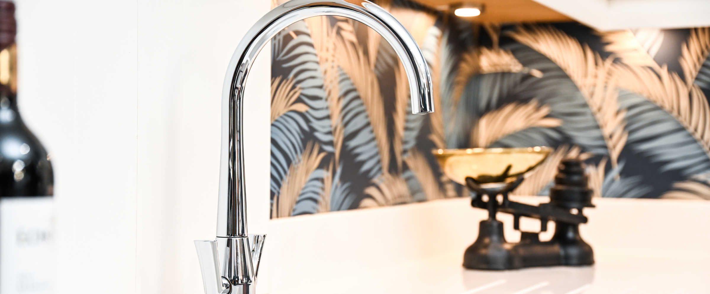 Chrome tap in kitchen showroom