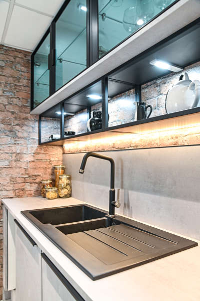 sink, tap and glass units in kitchen showroom